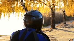 A biker removes his helmet Stock Footage