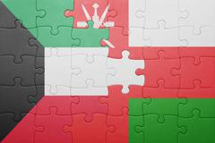 puzzle with the national flag of oman and kuwait - stock photo