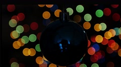 Christmas ball at background of blurred lights Stock Footage
