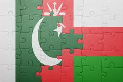 puzzle with the national flag of oman and pakistan - stock photo