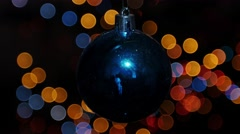 Christmas ball at background of blurred lights - stock footage