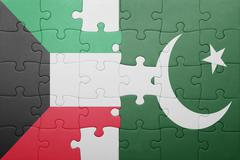 puzzle with the national flag of pakistan and kuwait - stock photo