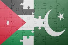 puzzle with the national flag of pakistan and jordan - stock photo