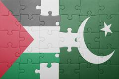 puzzle with the national flag of pakistan and palestine - stock photo