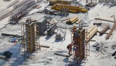 Construction site workers   building new apartments. silhouette crane working - stock footage