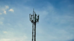 Medium shot Time Lapse of cell phone communications tower with clouds Stock Footage