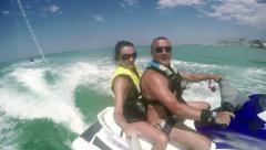 Couple on waverunner Stock Footage