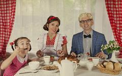 Retro styled family have breakfast Stock Photos