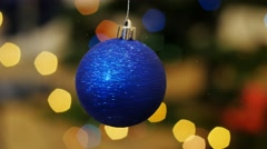 Christmas blue ball rotates at background bokeh - stock footage