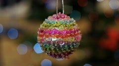 Christmas colorful ball shakes at background bokeh Stock Footage