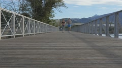 Couple of joggers running on riverside - stock footage