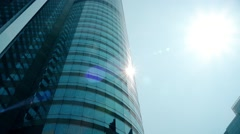 Hong Kong Stock Exchange building with walking people and fountain, sunny day. Stock Footage