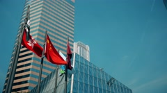 Hong Kong Stock Exchange (HKEx) square with flags. Speed-lapse. Stock Footage
