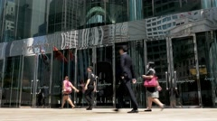 Hong Kong Stock Exchange (HKEx) building with walking people, during sunny day. Stock Footage