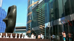 Hong Kong Stock Exchange (HKEx) building with walking people. Speed-lapse Stock Footage