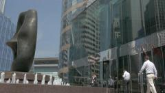 Hong Kong Stock Exchange building with walking people. Tilting shot. Stock Footage
