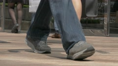 Low angle view of people legs walking in a busy city street. Speed-lapse. Stock Footage