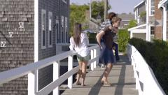 Guy Gives Girlfriend A Piggyback Ride And They Run With Their Friend On Bridge Stock Footage