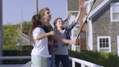 Multiethnic Teens Jump For Vacation Photos With Gopro Stick On Nantucket Island Stock Footage