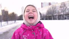 Close-up portrait of 4 year old funny girl bursting in laugh. Slow motion. Stock Footage