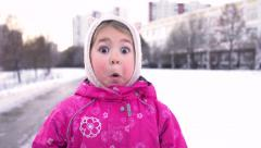 Close-up of 4 Year Old Little Funny Girl Acts Very Surprised on winter street. Stock Footage