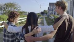 Multiethnic Teens Walk Down Road Together On Beautiful New England Seaside Road Stock Footage