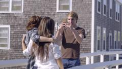 Friends Hang Out On Bridge, Boy Takes Photo Of Girls, Then They All Take Selfie Stock Footage