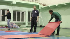 Preparations for the competition: the installation of the mat tatami Stock Footage