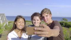 Group Of Multiethnic Teens Take Selfies At Overlook, Ocean Behind Them Stock Footage