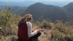Girl writing at a sunny forest mountain Stock Footage