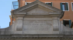 Latin inscription on a building in Campo San Gallo, Venice Stock Footage