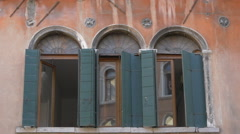 Arched windows with window shutters in Venice - stock footage