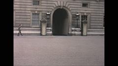 Vintage 16mm film, 1965, London, soldiers Buckingham castle guard duty Stock Footage