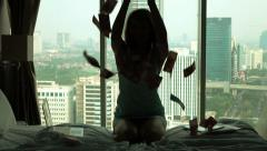 Successful businesswoman throwing money on bed, super slow motion 120fps Stock Footage