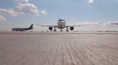 Airplane moves to camera 1 Stock Footage