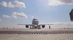 The tractor pushes the plane for takeoff Stock Footage