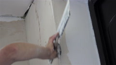 Applying putty wall on the corner Stock Footage