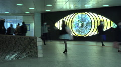 Time lapse of people passing by a moving art piece in Shinjuku Tokyo - stock footage