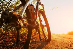 Detail of cyclist man feet riding mountain bike on outdoor Stock Photos