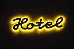 Stock Illustration of Illuminated hotel sign on the building in night