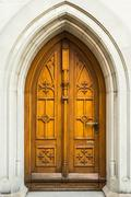 Old wooden door to the church in St. Gallen, Switzerland Stock Photos