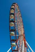 Underside view of a ferris wheel on blue sky background Stock Photos