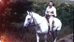Teenage Girl Rides Horse Stallion Horseback Vintage Film Home Movie 8532 Stock Footage