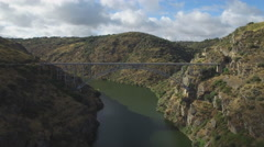 Fast aerial view of iron bridge over canyon in Zamora, Spain Stock Footage