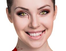 Stock Photo of Woman with vampire fangs