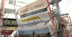Financial Times, International New York Times at press kiosk Stock Footage