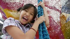 Slow motion of happy Asian gild playing with swing Stock Footage