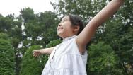 Stock Video Footage of Slow motion of Beautiful little Asian girl enjoy with nature in the park
