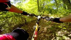 Ride a bike over terrain pov Stock Footage