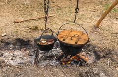 Medieval campfire, traditional cooking in nature Kuvituskuvat